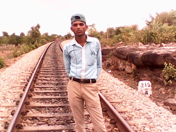 My Friend Wajir Who Helped Me A Lot During This Trip. He Just Could Not Click An Ideal Image Of Mine On These Tracks. However, I Got A Picture Perfect Of His, Which Also Highlights The Beauty Of Rail Tracks So Well!
