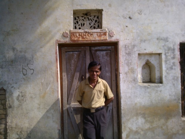 My real self lives in my village at this home..And please my home number is not 65 as inscribed on its wall...It's the highest score scored by one village kid in five overs :P :P :P