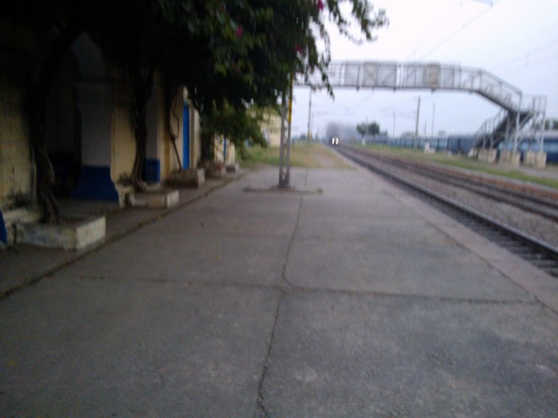An Express Train On Up Line Is Approaching Fast ( Main Line II) ..And you can notice that a passenger train is standing from quite a long time on loop line II :-(