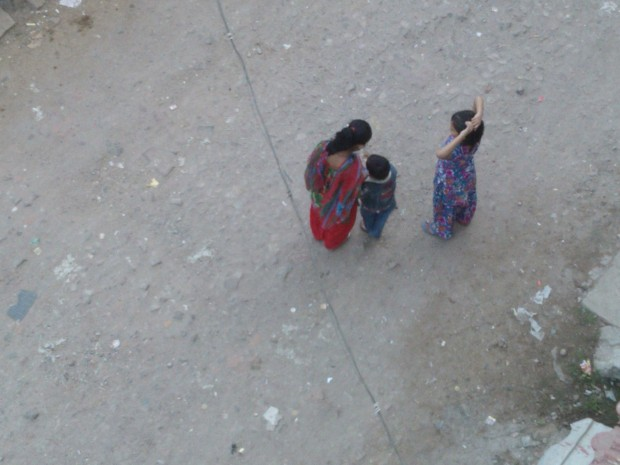 Kids engaged in serious discussion right in the middle of the street! Kids have become so serious nowadays :P :P