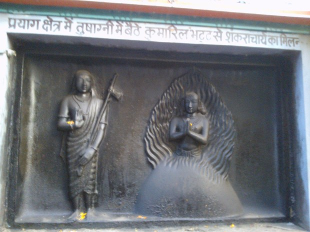 Various episodes from the life of  Sri Adi Shankara have been shown via images carved on the walls of the temple. In this one, we find him having a dialogue with another great philosopher of his times Kumarila Bhatta :-)