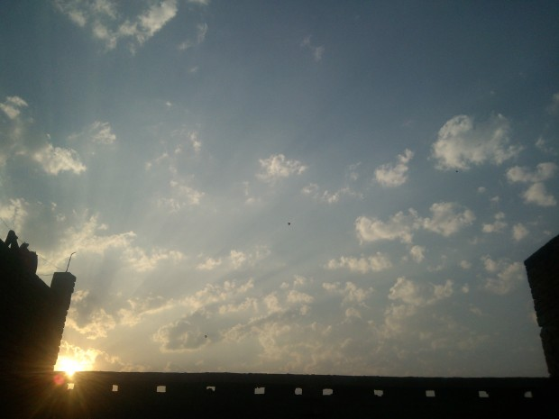 Allahabadis love flying kites :-) View of the beautiful sky over my roof :-)