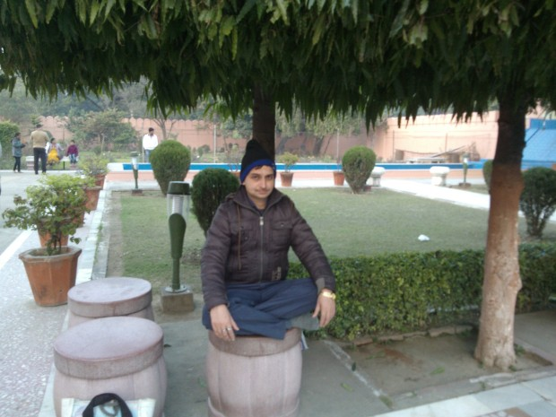 Brother-in-Law Sitting Under In Meditative Mudra Under Ashoka Tree :-) That's The Same Tree Under Which Sitaji Sat When She Was Held Captive At Lanka. It's Believed That This Tree Has The Power To Make You Rise Above All Worries :-)